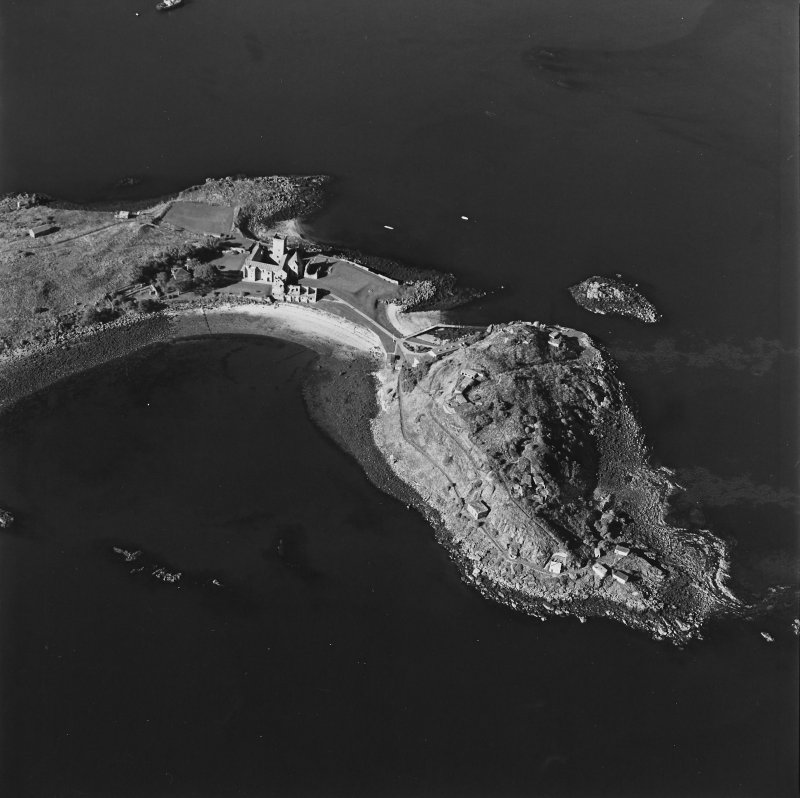 Oblique aerial view centred on the abbey with coast batteries adjacent, taken from the SE.