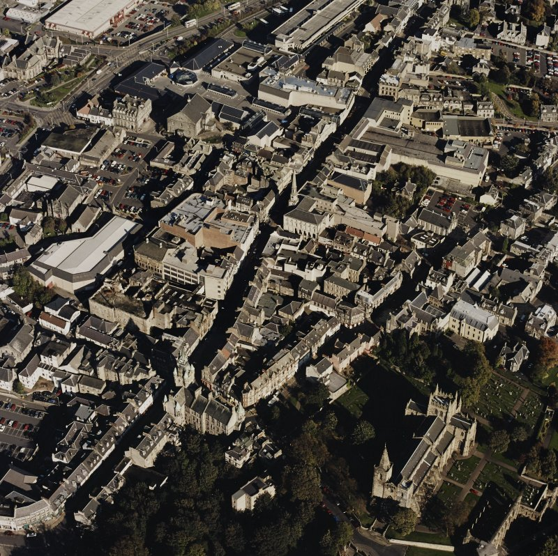 General oblique aerial view of Dunfermline High Street, Abbot Street and the abbey, taken from the SW.