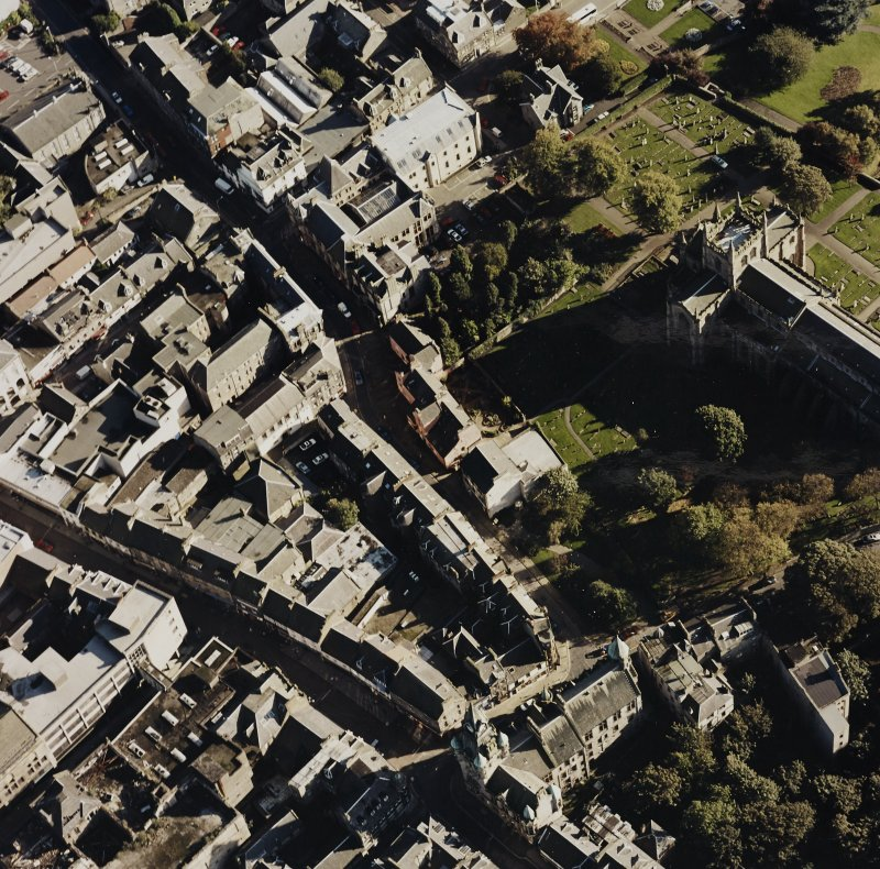 General oblique aerial view of Dunfermline High Street, Abbot Street and the abbey, taken from the NW.
