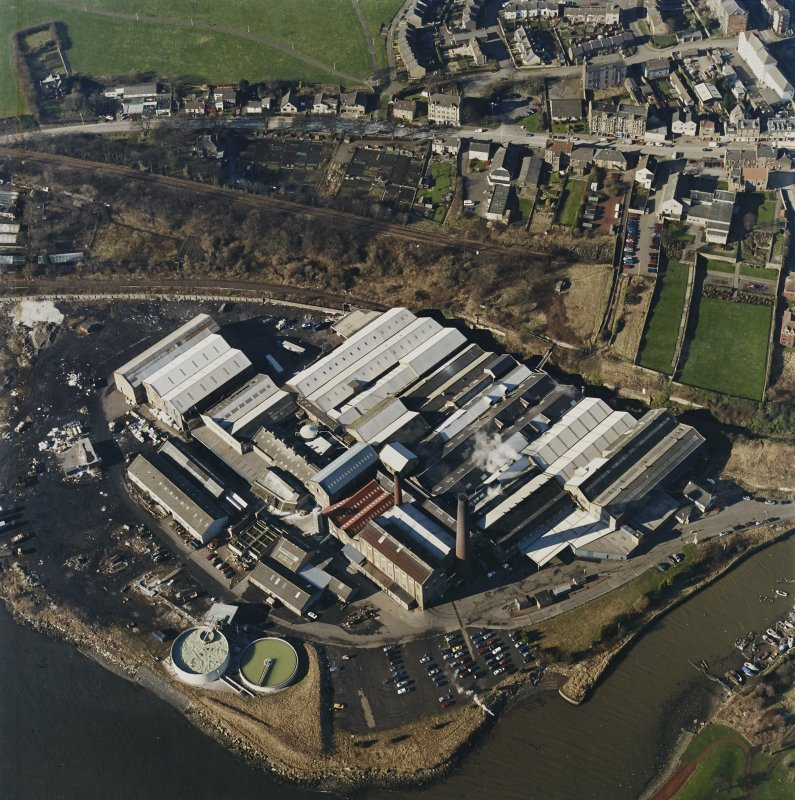 Oblique aerial view centred on the paper mill, taken from the ESE.