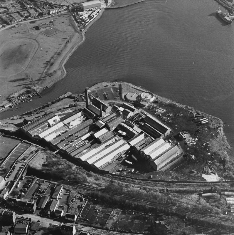 Oblique aerial view centred on the paper mill, taken from the NW.