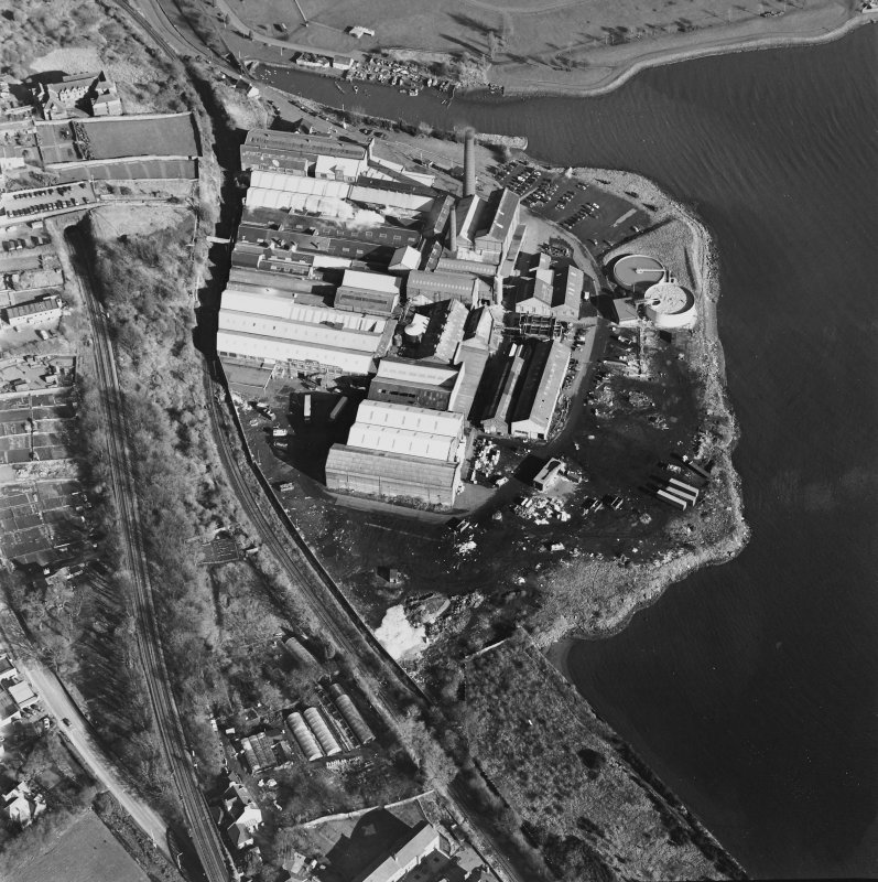 Oblique aerial view centred on the paper mill, taken from the WSW.