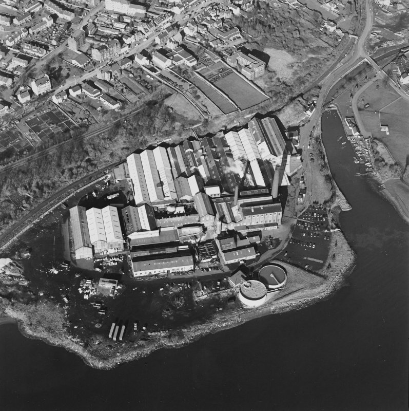 Oblique aerial view centred on the paper mill, taken from the SSE.