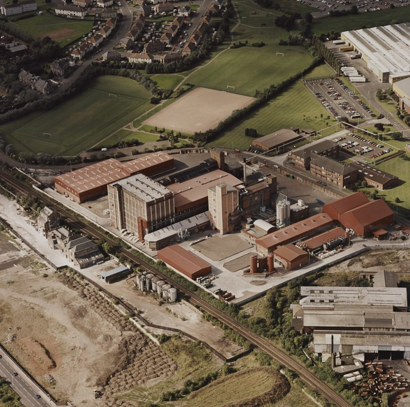 Oblique aerial view centred on the Linoleum works with offices adjacent, taken from the ESE.