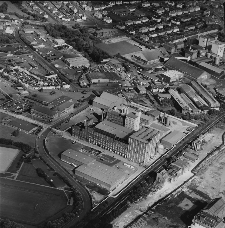 Oblique aerial view centred on the Linoleum works with offices adjacent, taken from the SSW.