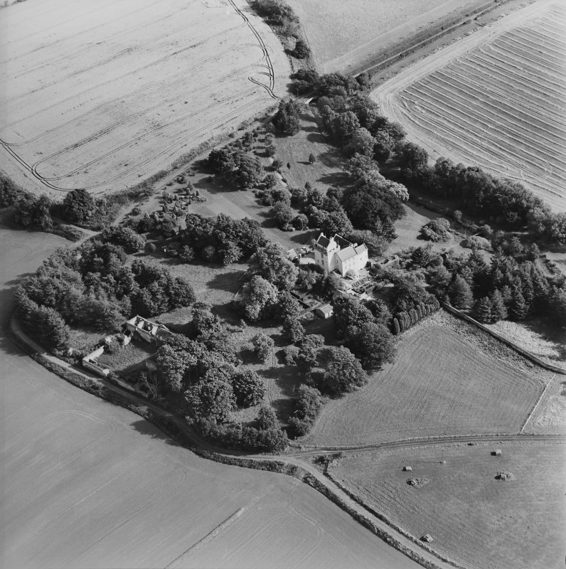 Oblique aerial view centred on the tower-house, taken from the WNW.