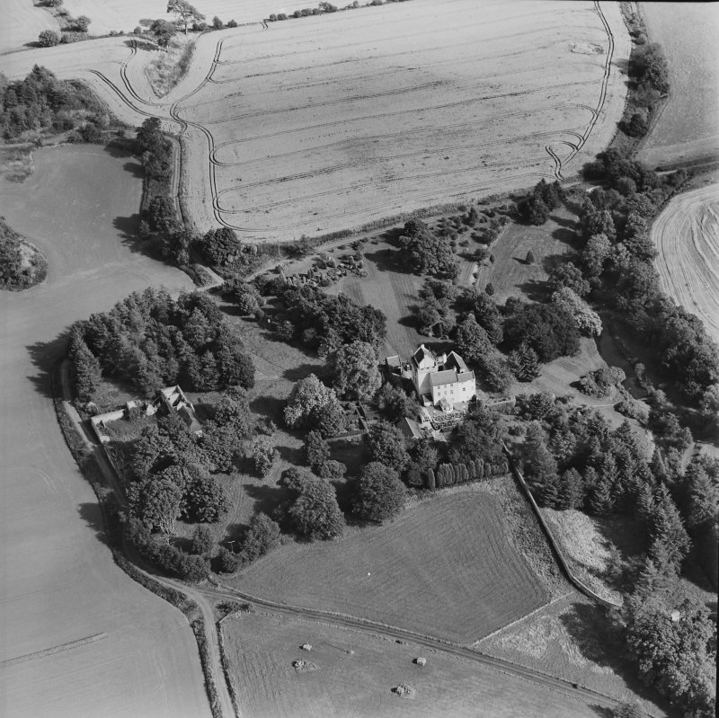 Oblique aerial view centred on the tower-house, taken from the W.