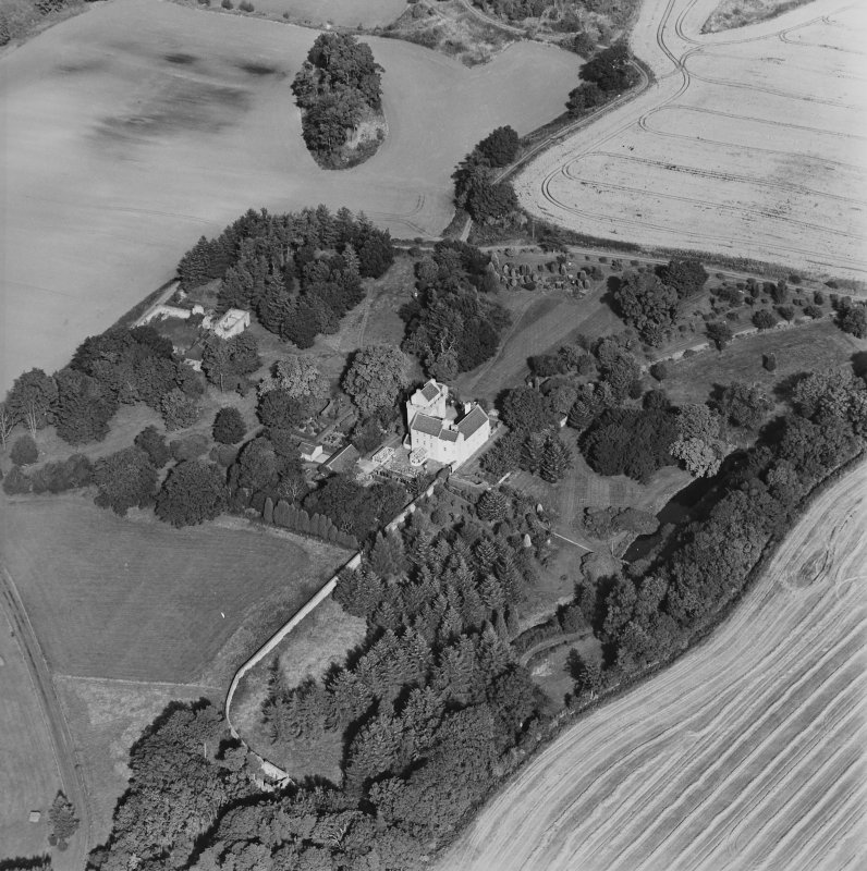 Oblique aerial view centred on the tower-house, taken from the SSW.