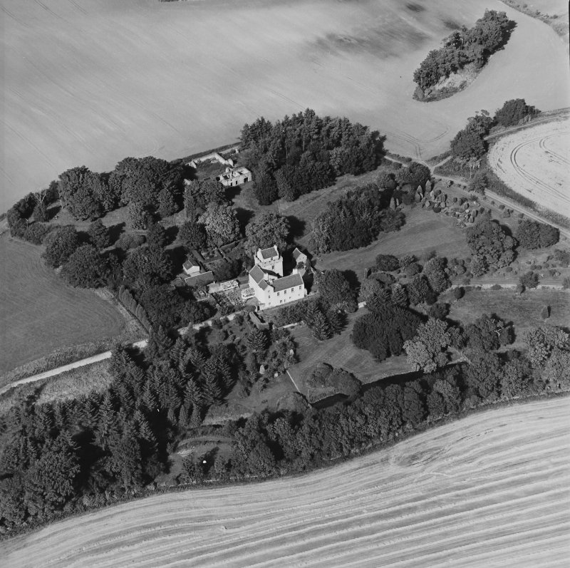 Oblique aerial view centred on the tower-house, taken from the SSE.