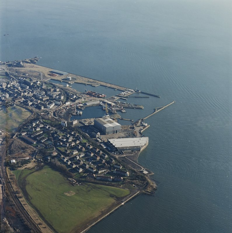 Oblique aerial view centred on Burntisland Harbour, taken from the NW.
