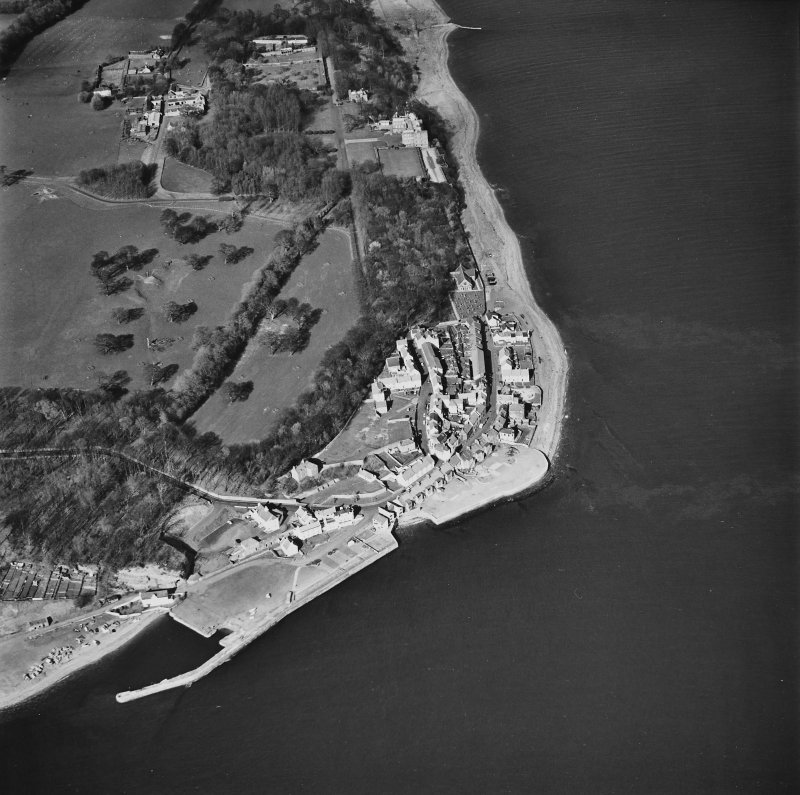 General aerial view of West Wemyss, including Wemyss church, Wemyss harbour, the Coxstool houses and Wemyss Castle, taken from the SW.