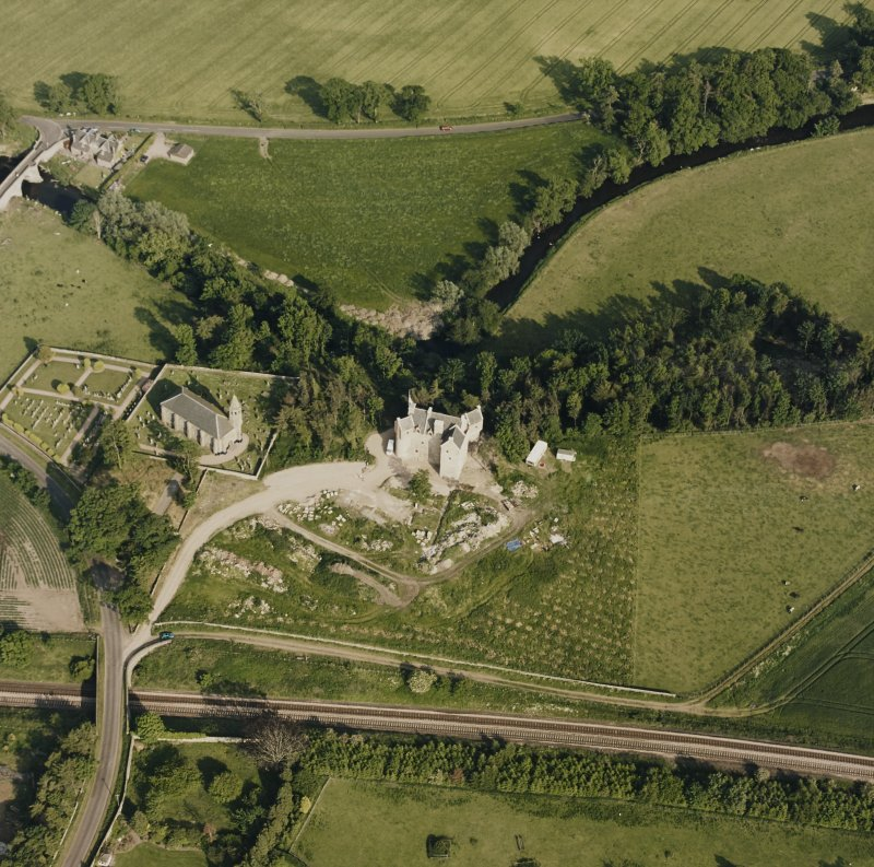 Dairsie Castle, oblique aerial view taken from the NW, centred on the remains of a castle, a church and Dairsie bridge.