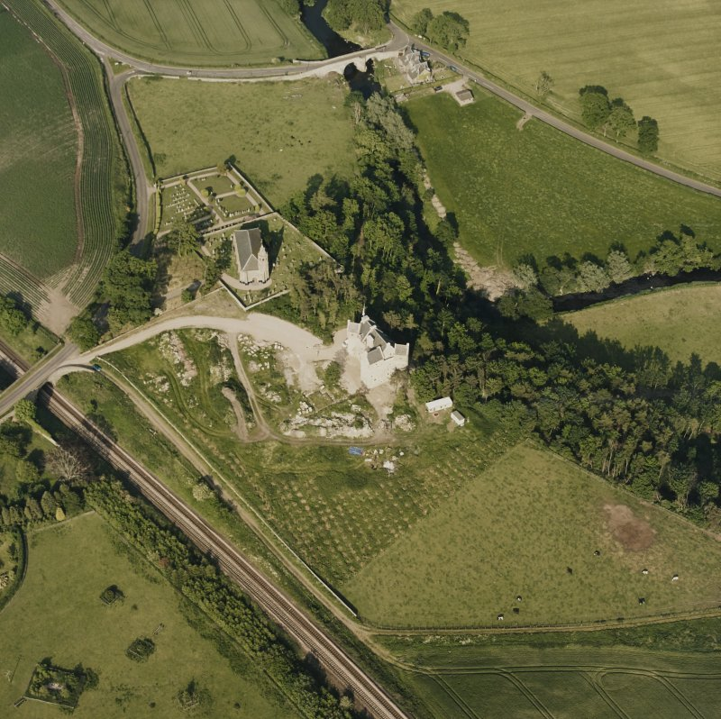 Dairsie Castle, oblique aerial view taken from the WSW, centred on the remains of a castle, a church and Dairsie bridge.