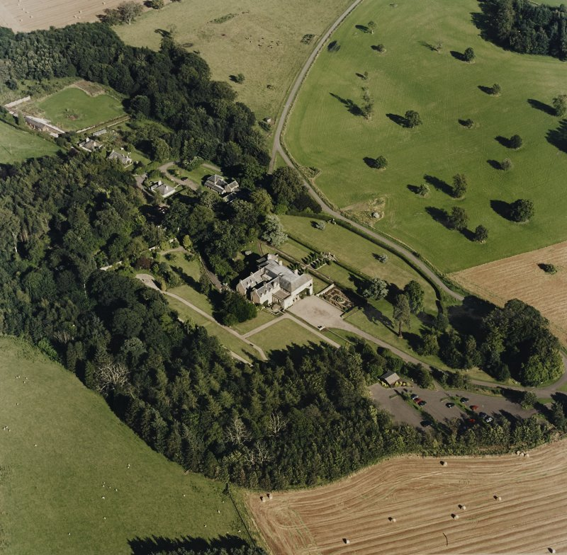 Oblique aerial view of Hill of Tarvit centred on the country house and garden, taken from the WNW.