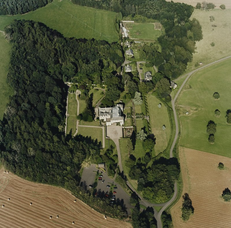 Oblique aerial view of Hill of Tarvit centred on the country house and garden, taken from the SW.