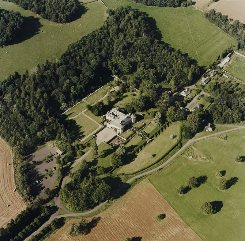 Oblique aerial view of Hill of Tarvit centred on the country house and garden, taken from the SSW.