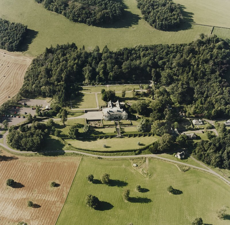 Oblique aerial view of Hill of Tarvit centred on the country house and garden, taken from the SSE.