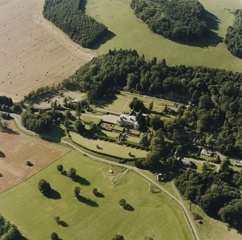 Oblique aerial view of Hill of Tarvit centred on the country house and garden, taken from the SE.