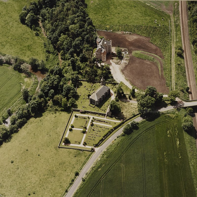 Oblique aerial view of Dairsie Castle and Dairsie Old Church centred on the castle and church, taken from the NE.