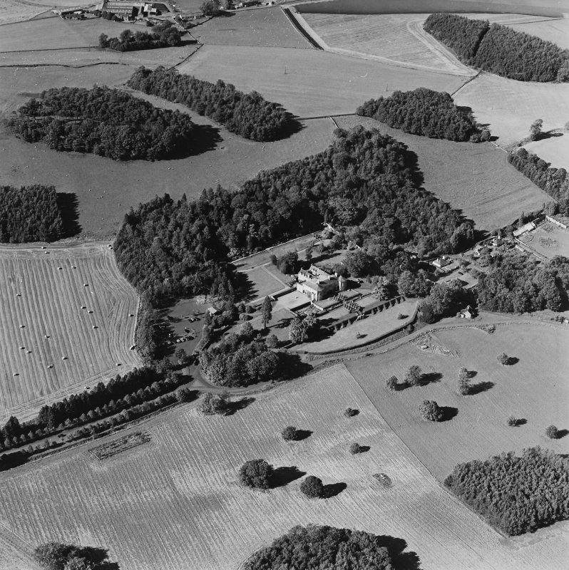 Oblique aerial view of Hill of Tarvit centred on the country house and garden, taken from the S.