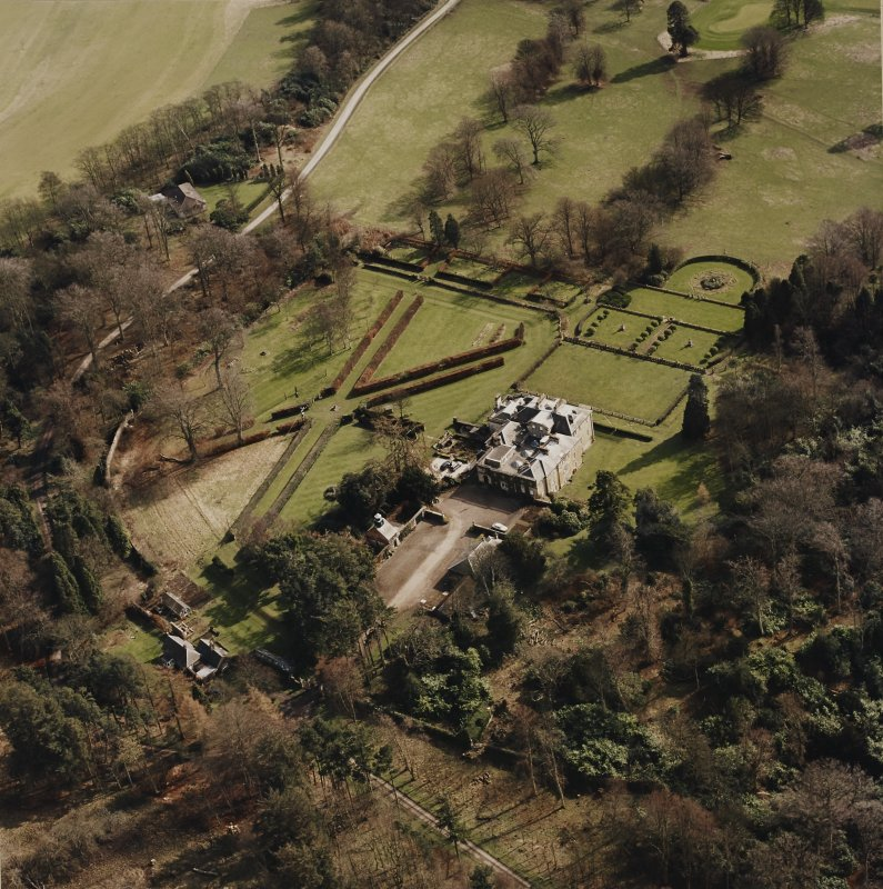 Oblique aerial view of Charleton House centred on a country house, taken from the NW.