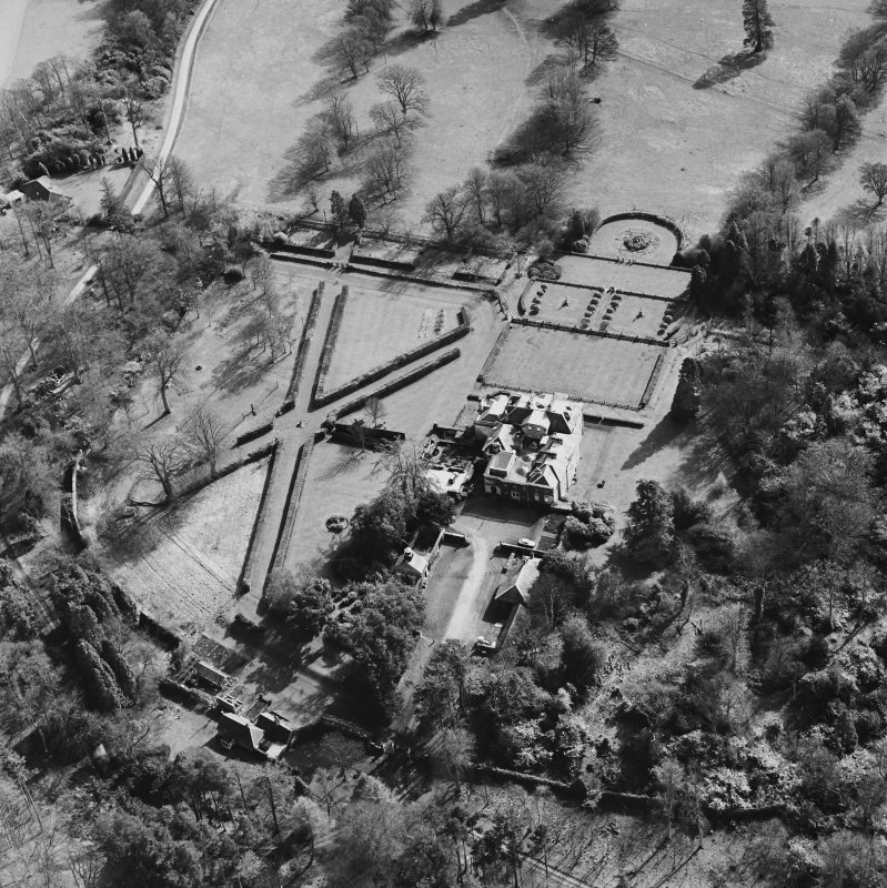 Oblique aerial view of Charleton House centred on a country house, taken from the W.