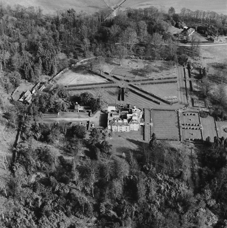 Oblique aerial view of Charleton House centred on a country house, taken from the SW.
