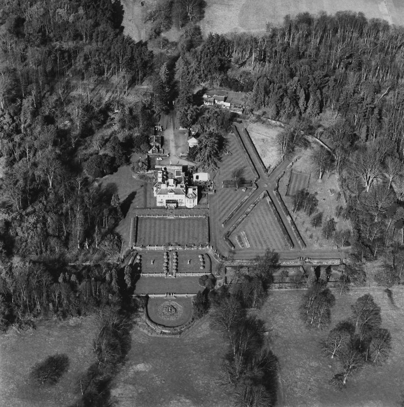 Oblique aerial view of Charleton House centred on a country house, taken from the SE.
