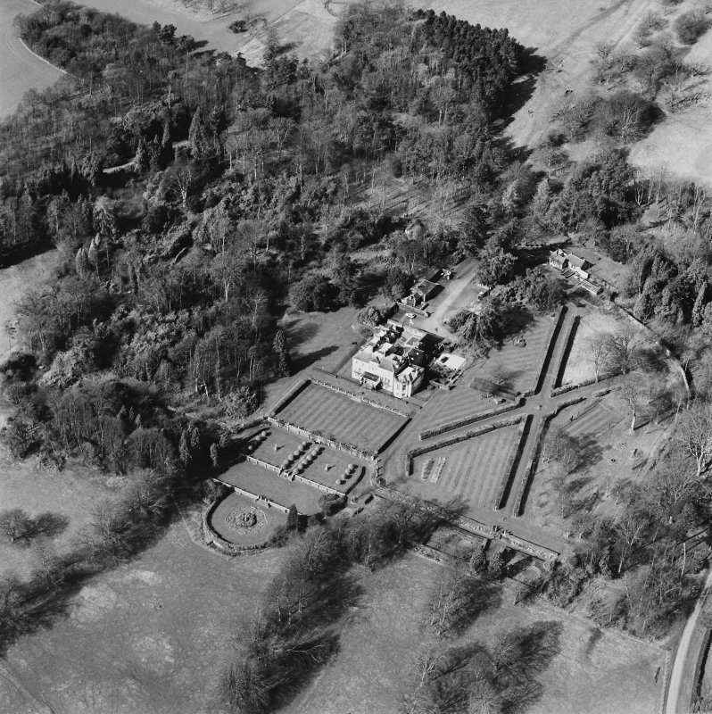 Oblique aerial view of Charleton House centred on a country house, taken from the E.