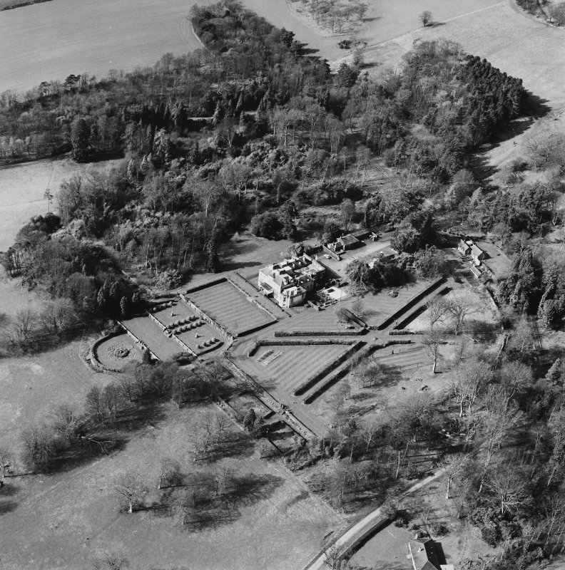 Oblique aerial view of Charleton House centred on a country house, taken from the NE.