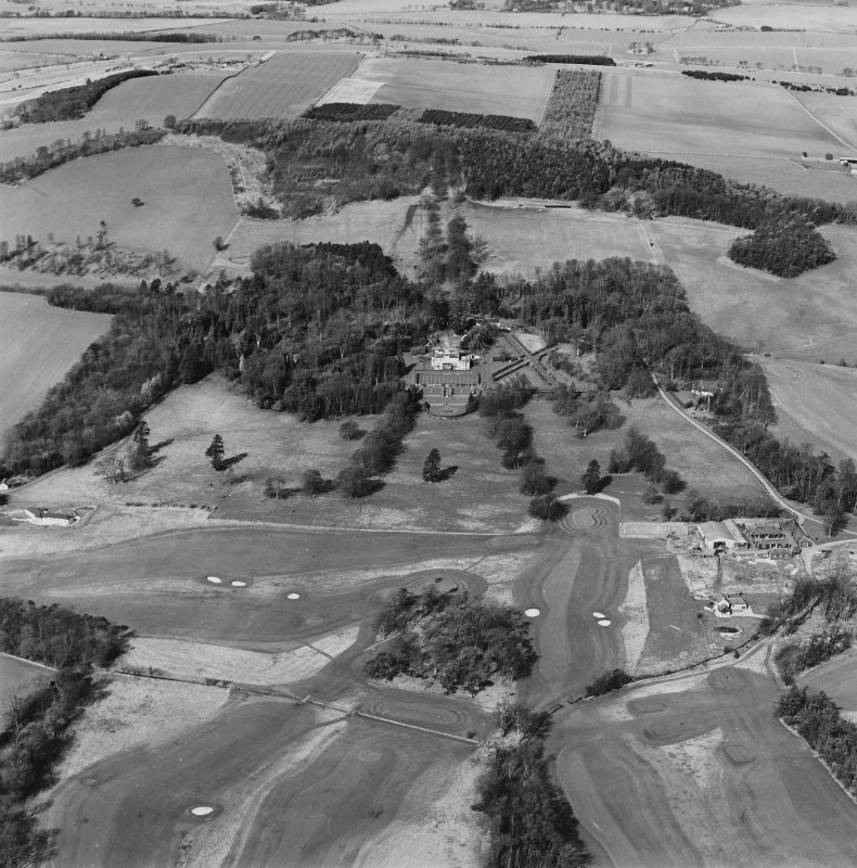 Distant oblique aerial view of Charleton House centred on a country house, taken from the SE.