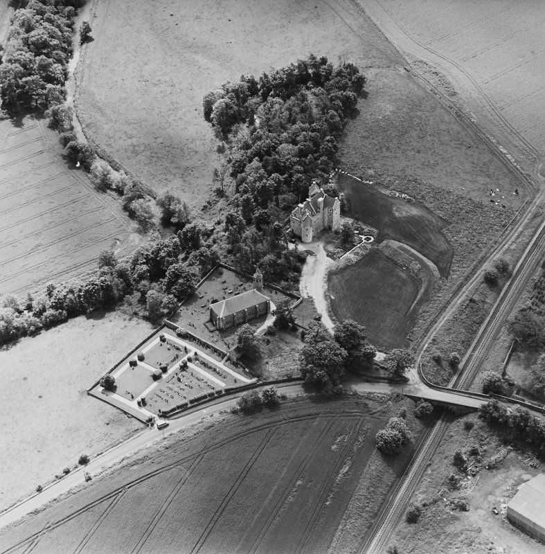 Oblique aerial view of Dairsie Castle and Dairsie Old Church centred on the castle and church, taken from the N.