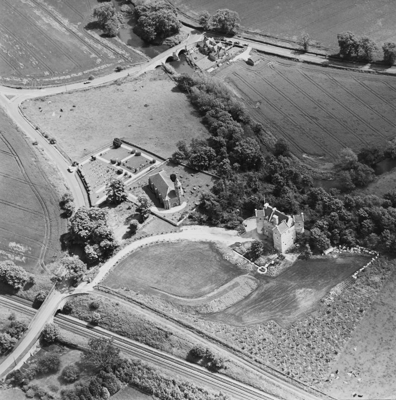 Oblique aerial view of Dairsie Castle and Dairsie Old Church centred on the castle and church, taken from the WNW.