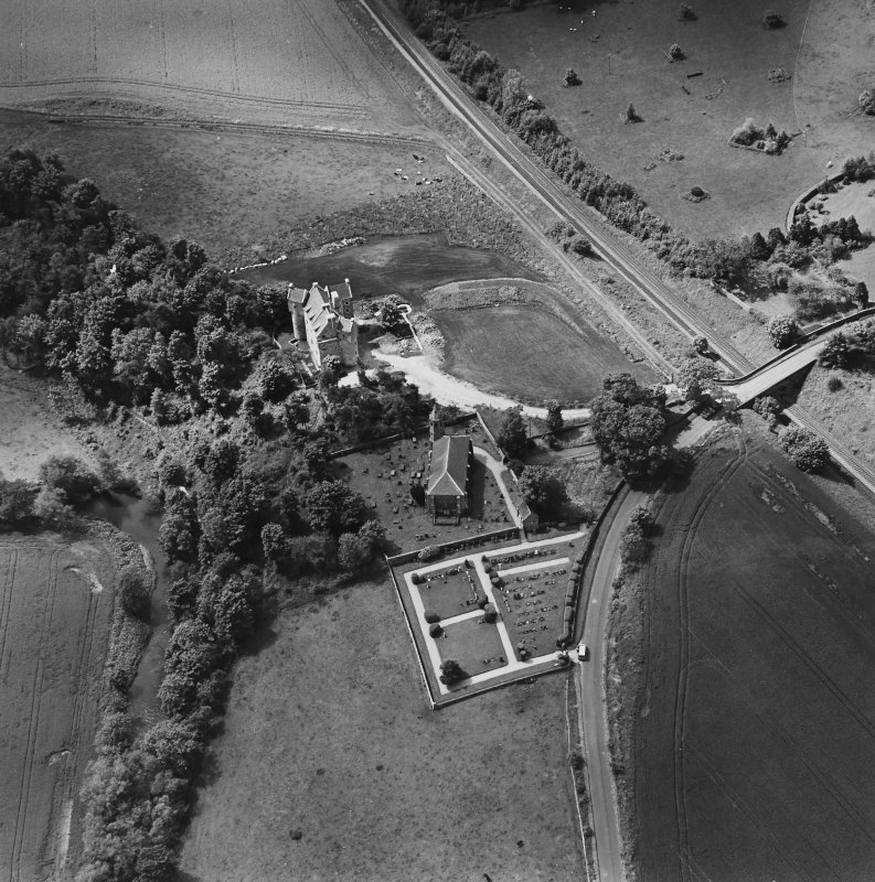 Oblique aerial view of Dairsie Castle and Dairsie Old Church centred on the castle and church, taken from the ENE.