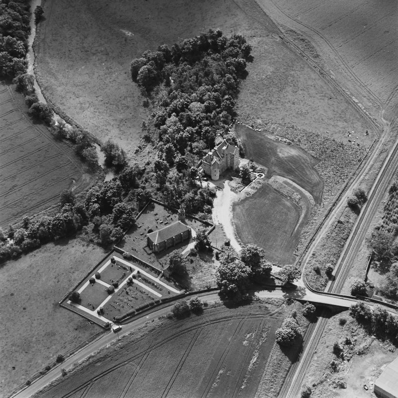 Oblique aerial view of Dairsie Castle and Dairsie Old Church centred on the castle and church, taken from the NNE.