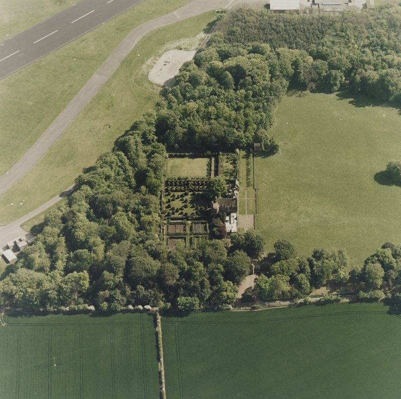 Aerial view of Earlshall country house, formal garden and dovecot, taken from the N.