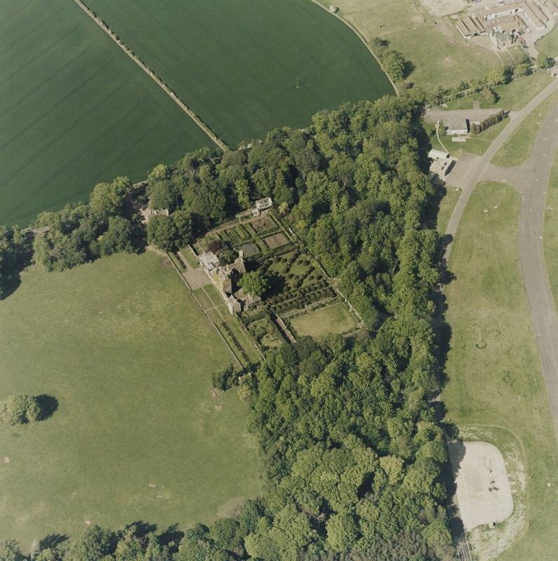 Aerial view of Earlshall country house, formal garden and dovecot, taken from the SSW.