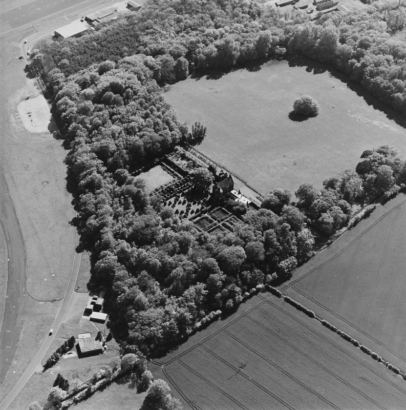 Aerial view of Earlshall country house, formal garden and dovecot, taken from the NE.
