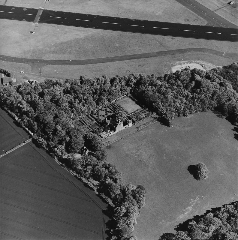 Aerial view of Earlshall country house, formal garden and dovecot, taken from the NW.