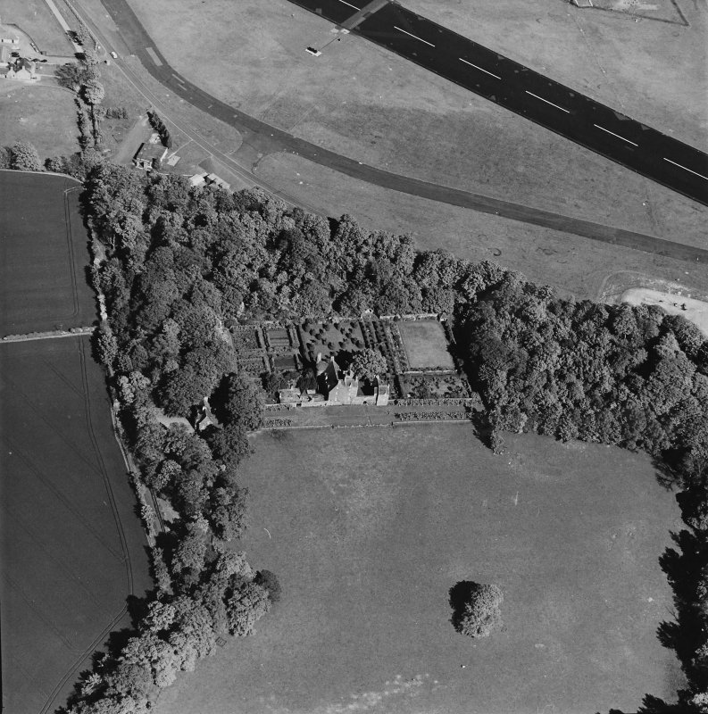 Aerial view of Earlshall country house, formal garden and dovecot, taken from the W.