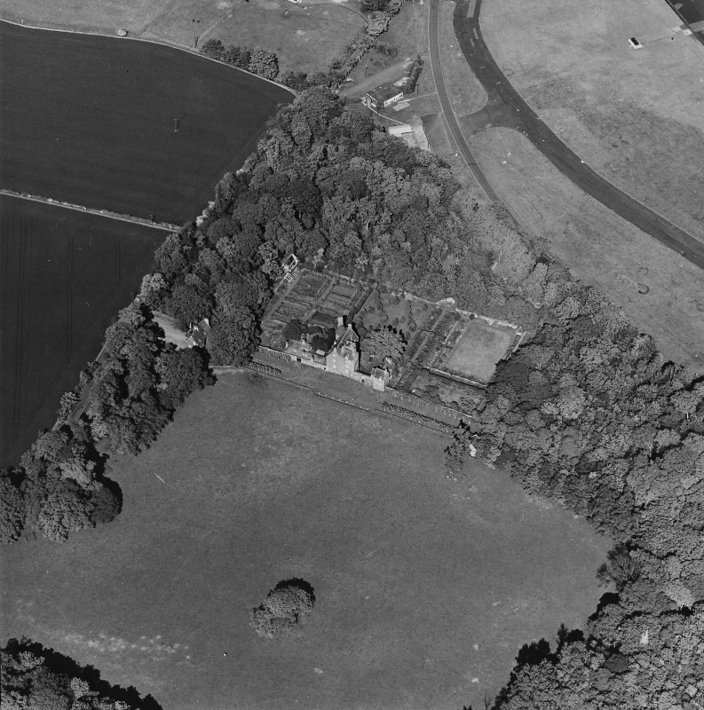 Aerial view of Earlshall country house, formal garden and dovecot, taken from the WSW.