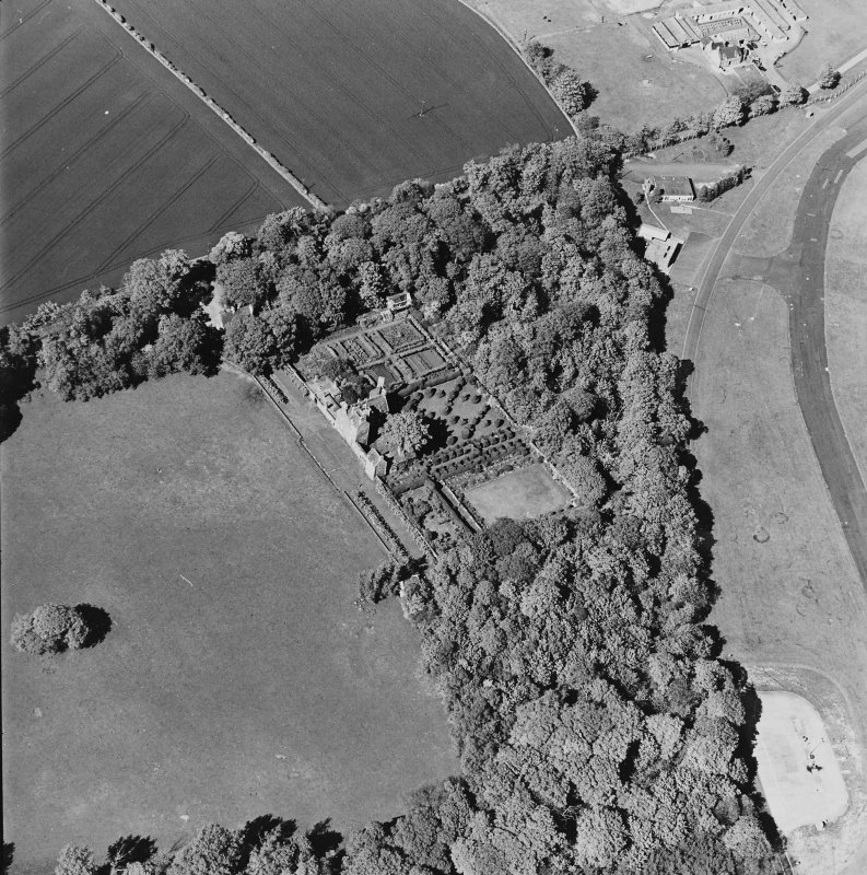 Aerial view of Earlshall country house, formal garden and dovecot, taken from the SW.