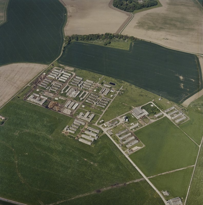 Oblique aerial view centred on the remains of the military camp, taken from the E.