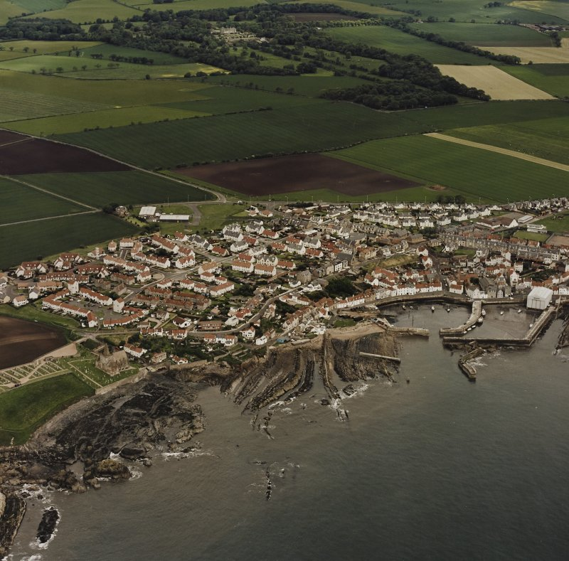 Oblique aerial view of St Monance centred on the village, church and harbour, taken from the S.