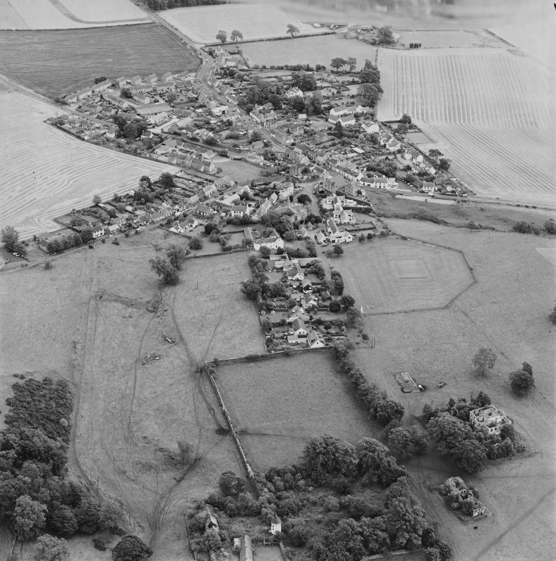 Oblique aerial view centred on the village of Upper Largo with walled garden and country house adjacent, taken from the NE.