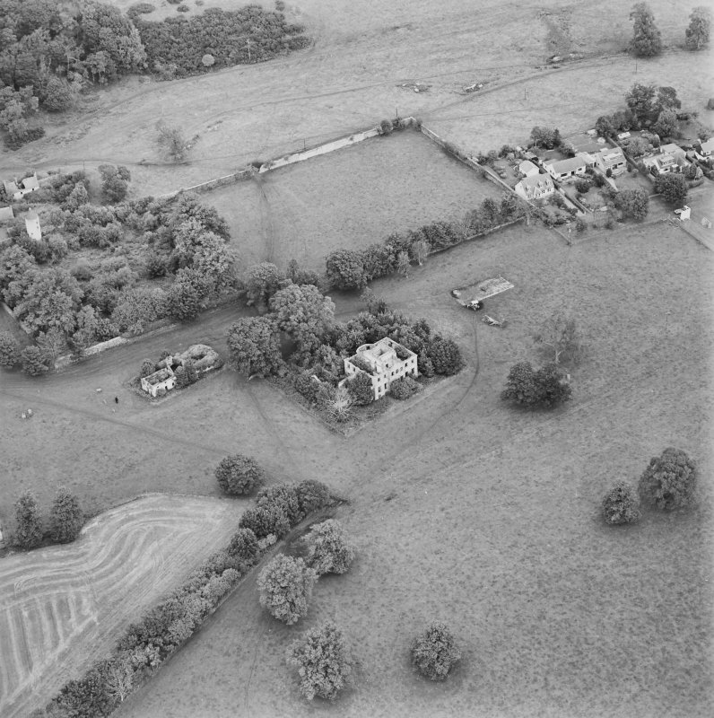 Oblique aerial view centred on the remains of the country house with stables, walled garden and tower house adjacent, taken from the SSW.