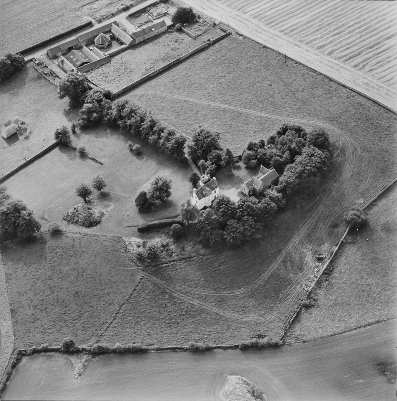 Oblique aerial view centred on Pitcullo castle with dovecot adjacent, taken from the NE.
