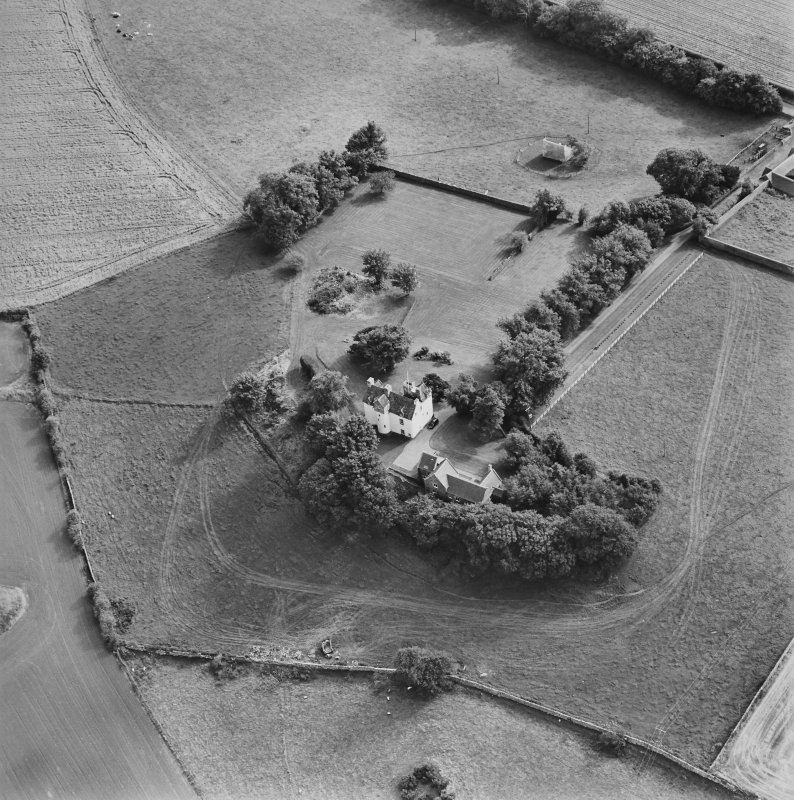 Oblique aerial view centred on Pitcullo castle with dovecot adjacent, taken from the NW.