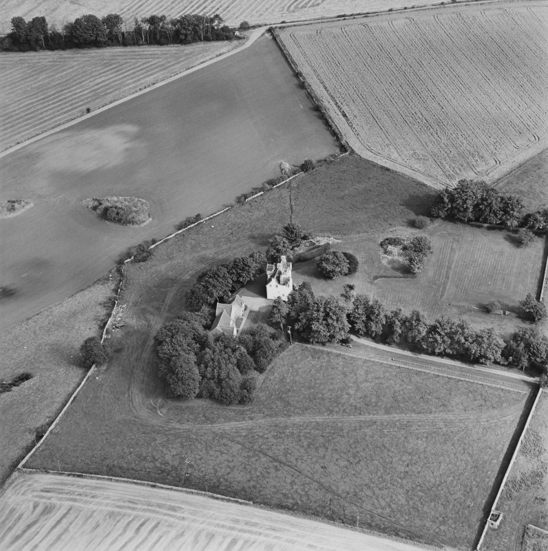 Oblique aerial view centred on Pitcullo castle, taken from the SW.