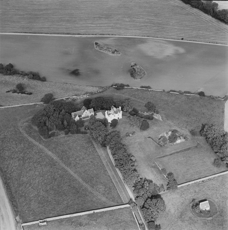 Oblique aerial view centred on Pitcullo castle with dovecot adjacent, taken from the SSE.